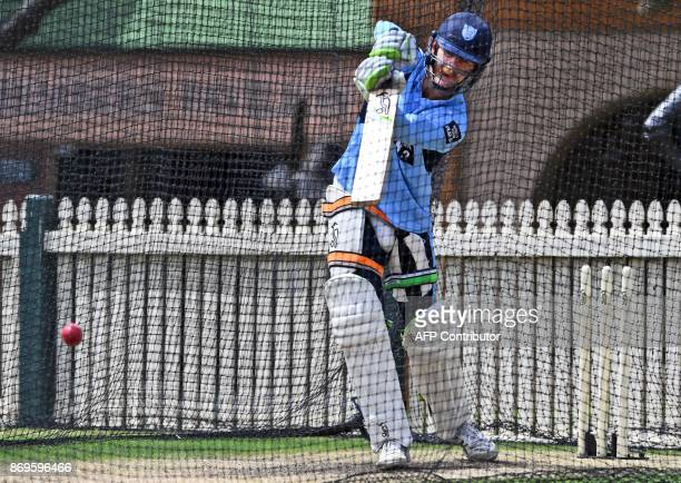 New South Wales batsman Daniel Hughes drives a delivery away while batting during training in Sydney on November 3 2017 Australian Test players are...