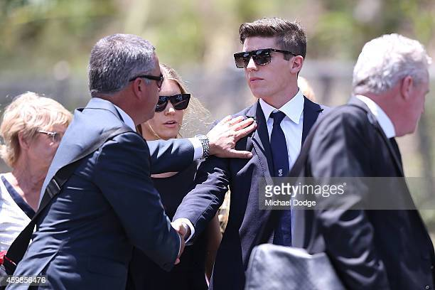 New South Wales cricketer Sean Abbott is supported when arriving during the Funeral Service for Phillip Hughes on December 3 2014 in Macksville...