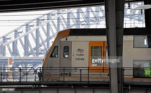 A New South Wales Government CityRail commuter train leaves the Circular Quay railway station in Sydney on February 2 2010 with the Sydney Harbour...