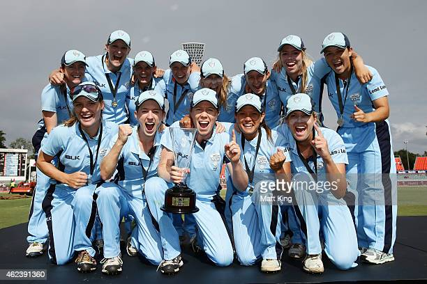 New South Wales pose with the WT20 trophy after winning the Women's Twenty20 final match between New South Wales and Victoria at Manuka Oval on...