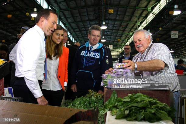New South Wales Premier Barry O'Farrell and Frances Abbott join Australian Opposition Leader Tony Abbott on the campaign at Sydney Markets on...