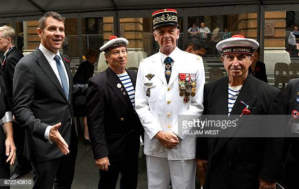 New South Wales premier Mike Baird joins General Francois Loeuillet of France and other French veterans after a Remembrance Day service at the...