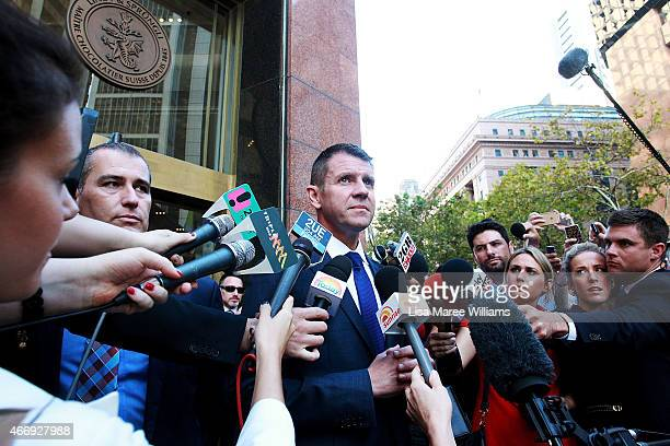 New South Wales Premier Mike Baird speaks to media outside the Lindt Cafe in Martin Place on March 20 2015 in Sydney Australia The cafe reopened to...