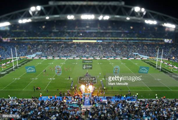 New South Wales run onto the field before game two of the State Of Origin series between the New South Wales Blues and the Queensland Maroons at ANZ...