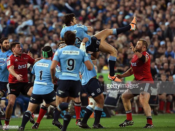 New South Wales Waratah's centre Adam AshleyCooper catches the high ball against the Canterbury Crusaders during the Super 15 rugby union final in...