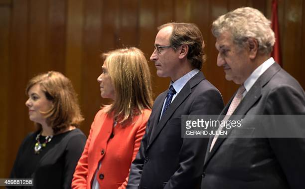 New Spanish Health Social Services and Equality Minister Alfonso Alonso poses with Deputy Prime Minister and Minister for the Presidency Soraya Saenz...