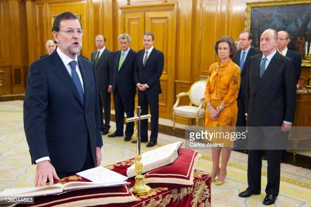 New Spanish Prime Minister Mariano Rajoy is sworn in in front of King Juan Carlos of Spain and Queen Sofia of Spain during a ceremony at the Zarzuela...