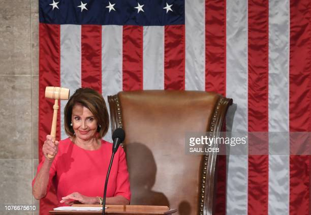 TOPSHOT New Speaker of the US House of Representatives Nancy Pelosi DCA holds the gavel during the opening session of the 116th Congress at the US...