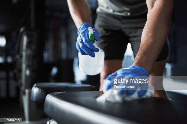 a new standard of gym safety - infectious disease stock pictures, royalty-free photos & images