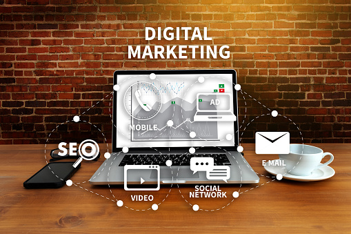 DIGITAL MARKETING new startup project MILLENNIALS Business team hands at work with financial reports and a laptop 959020654