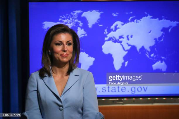 New State Department spokesperson Morgan Ortagus looks on after US Secretary of State Mike Pompeo spoke about the Trump administration's Cuba policy...