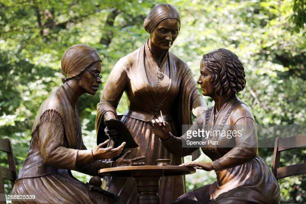 A new statue of women's rights pioneers Sojourner Truth Susan B Anthony and Elizabeth Cady Stanton is unveiled at Central Park on the 100th...