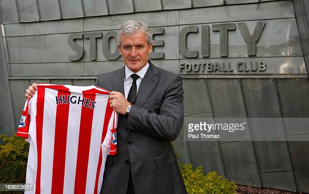 New Stoke City manager Mark Hughes poses for a photograph during the press conference at the Clayton Wood Training Ground on May 30, 2013 in...