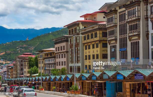 new street and buildings in thimphu, bhutan - thimphu stock pictures, royalty-free photos & images