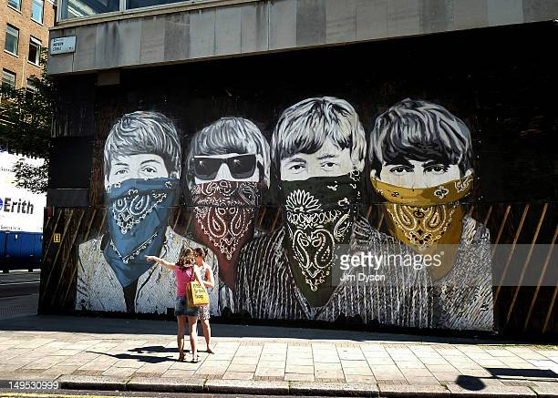 A new street artwork of The Beatles by controversial Los Angeles based French artist Thierry Guetta aka Mr Brainwash is pictured at the Old Sorting...