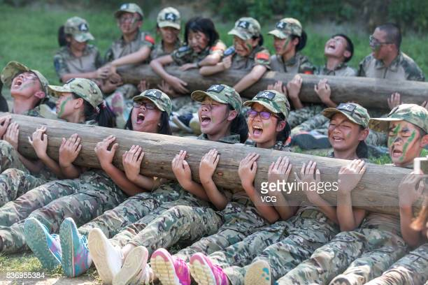New students of a middle school carrying logs do situps during a military training on August 18 2017 in Hangzhou Zhejiang Province of China 272 new...