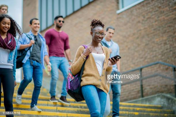 new students on a college campus - community college stock pictures, royalty-free photos & images