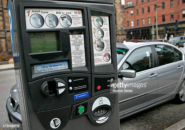 New style parking meters on Newbury Street which accept coins dollar bills certain credit cards and debit cards