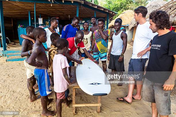 new surfboard for the bureh beach surf club - sierra leone stock pictures, royalty-free photos & images