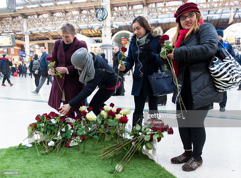 A new survey by Asda has revealed over half of British women have never received flowers on Valentine's Day and Dave is the most likely to forget his loved one this year. Asda has created a living floral billboard allowing Londoners, like Dave to take a single red rose for their Valentine #dontbedave at Victoria Station on February 13, 2015 in London, England.