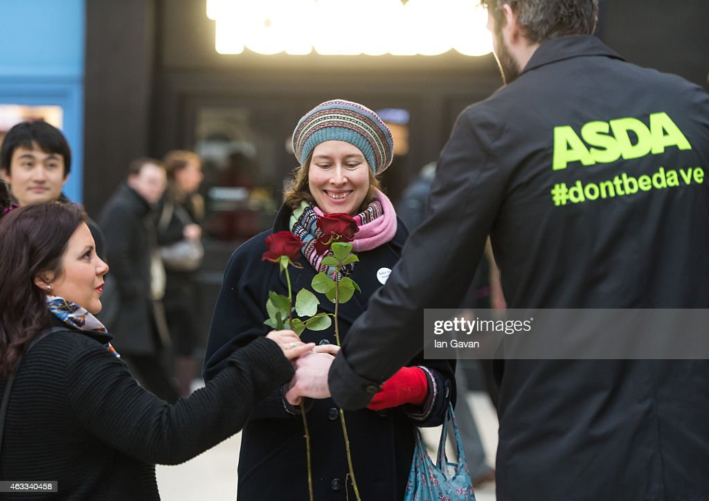 A new survey by Asda has revealed over half of British women have never received flowers on Valentine's Day and Dave is the most likely to forget his loved one this year. Asda and flower designer Joseph Massie have created a living floral billboard allowing Londoners, like Dave to take a single red rose for their Valentine #dontbedave at Victoria Station on February 13, 2015 in London, England.