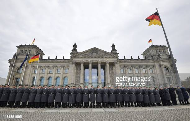 New swornin recruits of German Armed Forces Bundeswehr take part in a ceremonial oath on November 12 2019 in front of the Reichstag building which...