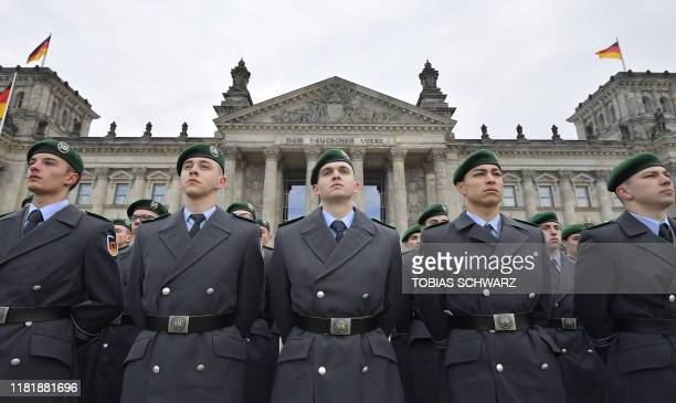New sworn-in recruits of German Armed Forces Bundeswehr take part in a ceremonial oath on November 12, 2019 in front of the Reichstag building, which...