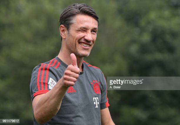 New team coach Niko Kovac of FC Bayern Muenchen gives a thumb up as he arrives for his first training session at the club's Saebener Strasse training...