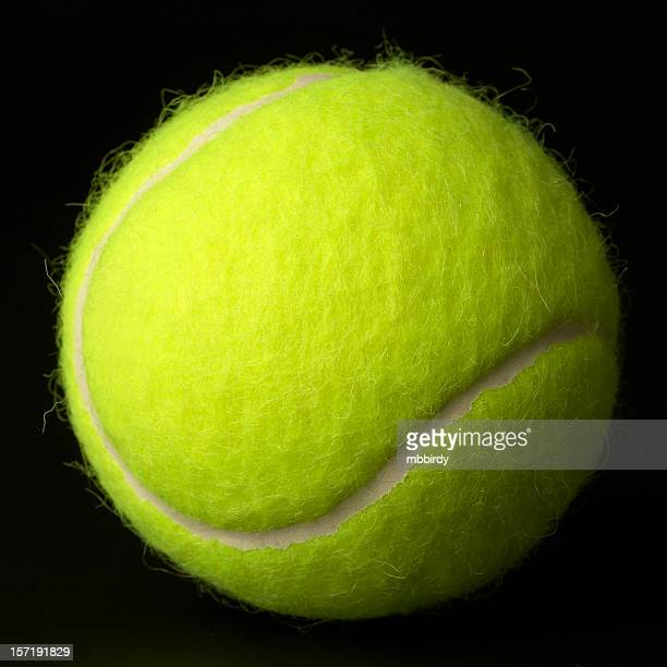 new tennis ball. - tennis ball stock pictures, royalty-free photos & images