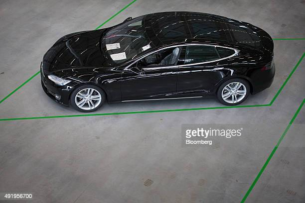 A new Tesla Model S automobile stands in a delivery area ahead European shipping following final assembly at the Tesla Motors Inc factory in Tilburg...