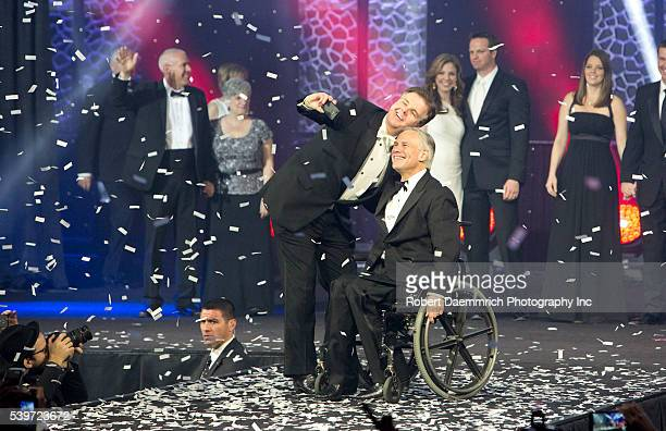 New Texas Governor Greg Abbott celebrates his inauguration as the 48th Governor of Texas onstage by taking a selfie with Lt Gov Dan Patrick at the...