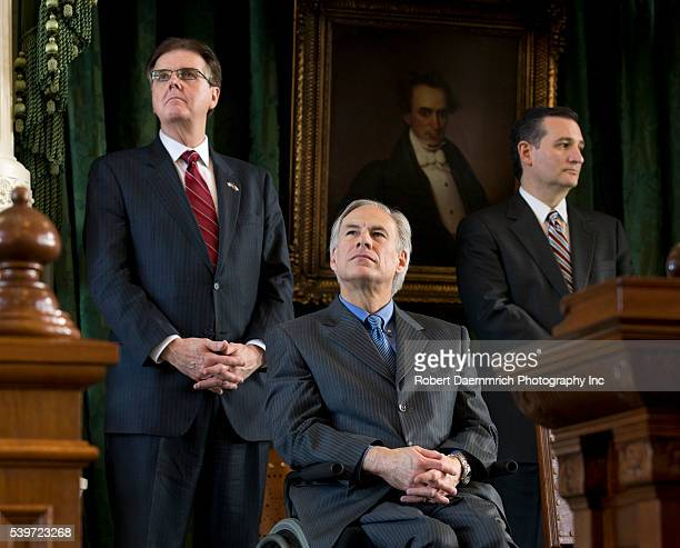New Texas Lt Gov Dan Patrick l listens with incoming Texas Gov Greg Abbott and US Sen Ted Cruz during transition ceremonies at the Texas Capitol...