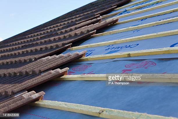 new tiled roof being built pr - rooftop stock pictures, royalty-free photos & images