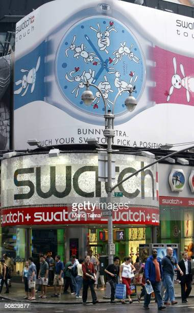 A new Times Square Swatch watch billboard featuring six pairs of rabbits in various sexual positions is seen May 12 2004 in New York City The...