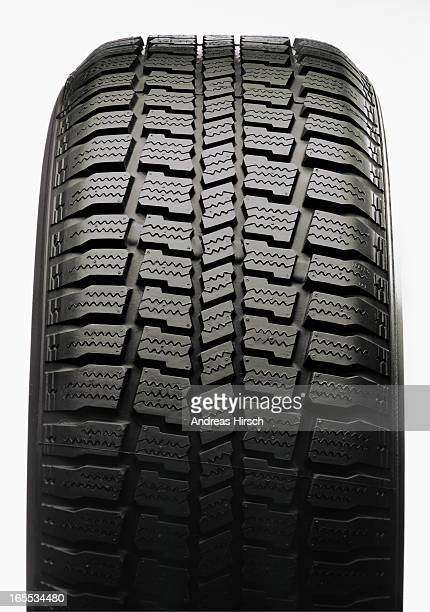 New tire on white background