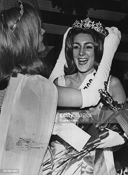 FEB 12 1967 FEB 13 1967 New Titlist Gets Crown Kim Kelly of 3154 S Winona court Denver is crowned Miss Colorado University at pageant Sunday in...