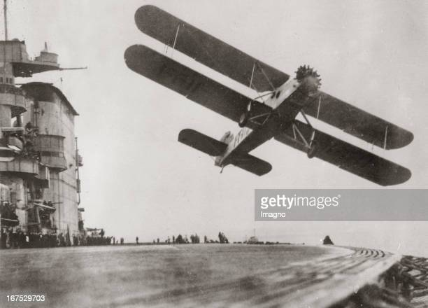 A new torpedo aeroplane of the US Navy starts from the aircraft carrier USS Lexington during a manoeuvre near the coast of California November 1932...