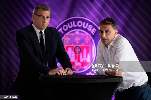 New Toulouse Football Club President Damien Comolli and former TFC President Olivier Sadran pose during a joint press conference on July 22 at the...