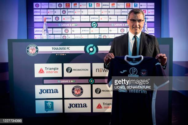 New Toulouse Football Club President Damien Comolli poses with a team jersey during a press conference on July 22 at the Stadium de Toulouse in...