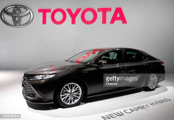 A new Toyota Camry hybrid automobile is on display during the second press day of the Paris Motor Show at the Parc des Expositions at the Porte de...