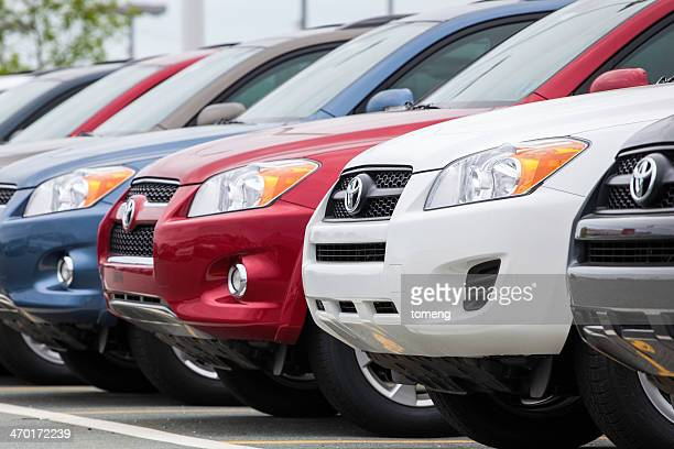 new toyota rav4 vehicles in a row at car dealership - toyota motor co stock pictures, royalty-free photos & images