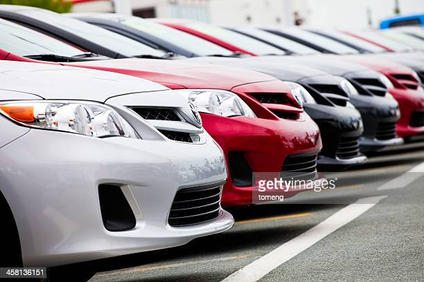 new toyota vehicles in a row at car dealership - toyota motor co stock pictures, royalty-free photos & images