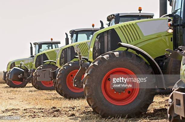 new tractors on field - tractor stock pictures, royalty-free photos & images
