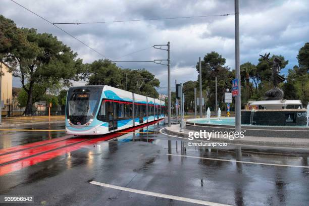 new tram line during trial run in izmir. - emreturanphoto stock pictures, royalty-free photos & images