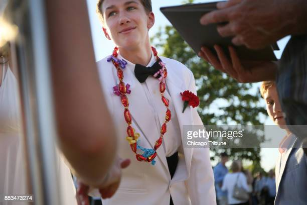 New Trier High School senior Ben Matejka greets wellwishers following his graduation ceremony at the Sears Centre Arena on Sunday June 4 2017