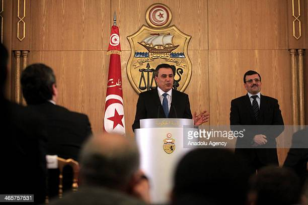New Tunisian Prime Minister Mehdi Jomaa and outgoing Prime Minister Ali Larayedh hold a press conference after Ali Larayedh hands over his office to...