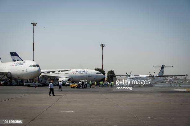 A new twin engine ATR 72600 turboprop aircraft right taxis after landing at Mehrabad International airport in Tehran Iran on Sunday Aug 5 2018...
