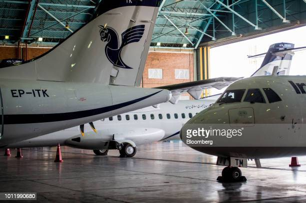 New twin engine ATR 72600 turboprop aircraft sit in a hangar following their arrival at Mehrabad International airport in Tehran Iran on Sunday Aug 5...