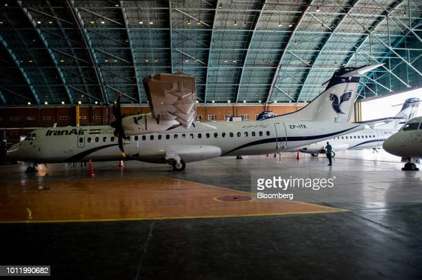 A new twin engine ATR 72600 turboprop aircraft sits in a hangar following its arrival at Mehrabad International airport in Tehran Iran on Sunday Aug...