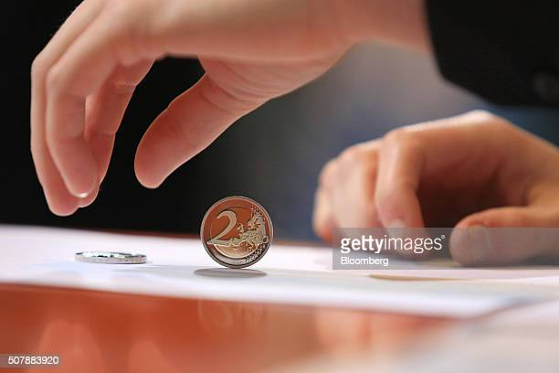 A new two euro currency coin is unveiled at the Chancellery in Berlin Germany on Monday Feb 1 2016 Germany's Chancellor Angela Merkel won time to...